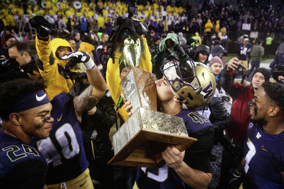 Washington kicker Tristan Vizcaino kisses the Apple Cup following the Huskies 41-14 win over Washington State at Husky Stadium on Saturday, Nov. 25, 2017. Photo: GRANT HINDSLEY, SEATTLEPI.COM / SEATTLEPI.COM