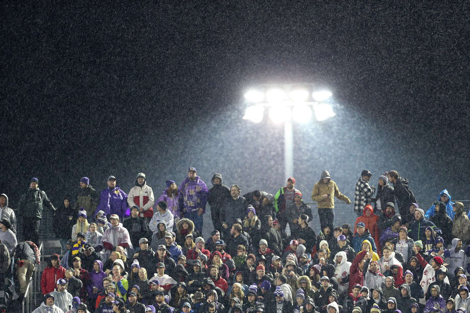 Fans brave the rain during the first half of the Apple Cup at Husky Stadium on Saturday, Nov. 25, 2017. Photo: GRANT HINDSLEY, SEATTLEPI.COM / SEATTLEPI.COM