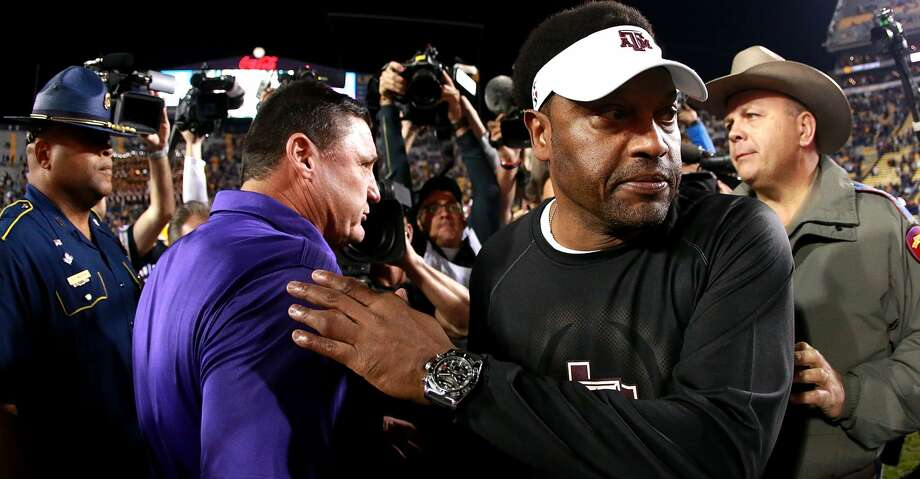 BATON ROUGE, LA - NOVEMBER 25:  Head coach Kevin Sumlin of the Texas A&M Aggies shakes hands with Head coach Ed Orgeron of the LSU Tigers after his team was defeated by LSU 45 - 21 at Tiger Stadium on November 25, 2017 in Baton Rouge, Louisiana. (Photo by Sean Gardner/Getty Images) Photo: Sean Gardner/Getty Images