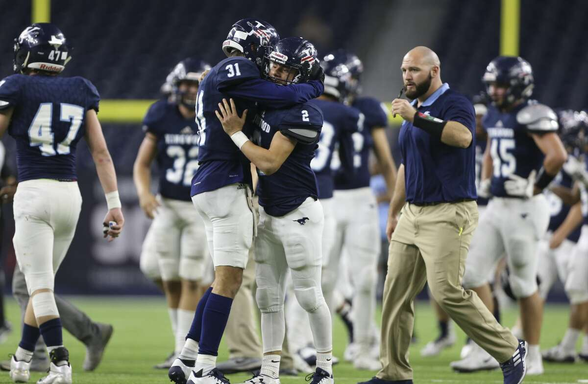 Kingwood's Blake Herrera (31) and Blake Parr (2) hug each other after the team won the Class 6A Division 2 area playoffs game over Clear Lake at NRG Stadium on Saturday, Nov. 25, 2017, in Houston. The Kingwood Mustangs defeated the Clear Lake Falcons 38-30. ( Yi-Chin Lee / Houston Chronicle )
