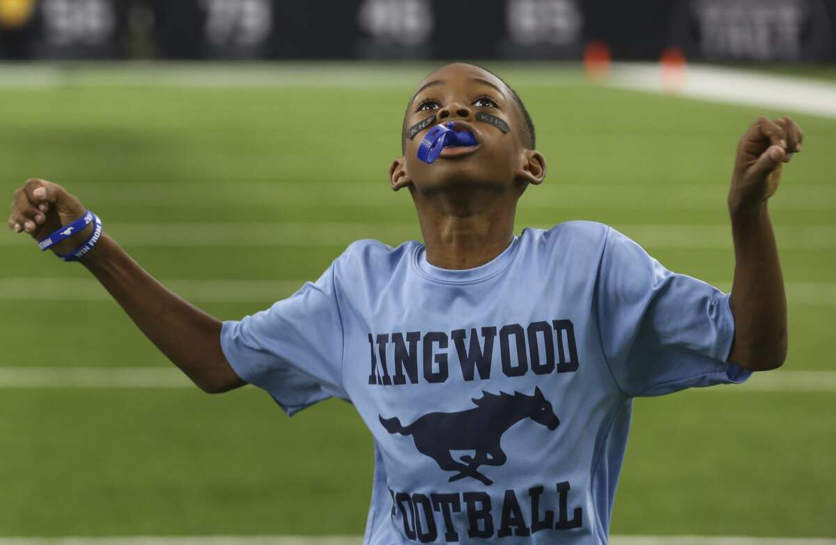 A Kingwood ball boy is pumped before the Class 6A Division 2 area playoffs game against Clear Lake at NRG Stadium on Saturday, Nov. 25, 2017, in Houston. ( Yi-Chin Lee / Houston Chronicle )