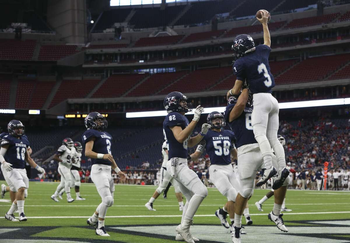 Kingwood players celebrate Matt Slayton (3) after he scored a touch down during the first quarter of the Class 6A Division 2 area playoffs game against Clear Lake at NRG Stadium on Saturday, Nov. 25, 2017, in Houston. ( Yi-Chin Lee / Houston Chronicle )