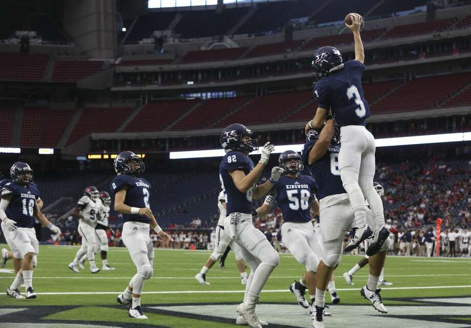 Kingwood players celebrate Matt Slayton (3) after he scored a touch down during the first quarter of the Class 6A Division 2 area playoffs game against Clear Lake at NRG Stadium on Saturday, Nov. 25, 2017, in Houston.  ( Yi-Chin Lee / Houston Chronicle ) Photo: Yi-Chin Lee/Houston Chronicle