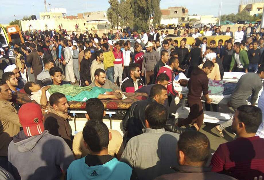 Injured people are evacuated from the scene of a militant attack on a mosque in Bir al-Abd in the northern Sinai Peninsula of Egypt on Friday, Nov. 24, 2017. In the deadliest-ever attack by Islamic extremists in Egypt, militants assaulted a crowded mosque Friday during prayers, blasting helpless worshippers with gunfire and rocket-propelled grenades and blocking their escape routes. More than 200 people were killed before the assailants got away. (AP Photo) Photo: Associated Press / AP