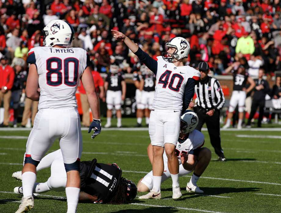 Connecticut place kicker Michael Tarbutt (40) points as he watches a field goal against Cincinnati during the first half of an NCAA college football game, Saturday, Nov. 25, 2017, in Cincinnati. (Gary Landers/The Cincinnati Enquirer via AP) Photo: Gary Landers, AP / Gary Landers