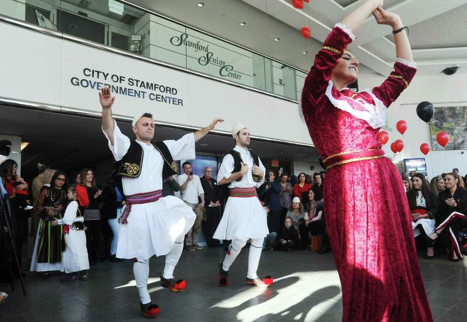 Members of the Bashkimi Dance troupe, from Boston, Mass., perform the traditional Valle Came dance during the Albanian Independence Day celebration inside Government Center in downtown Stamford, Conn. on Sunday, Nov. 26, 2017. Photo: Michael Cummo / Hearst Connecticut Media / Stamford Advocate