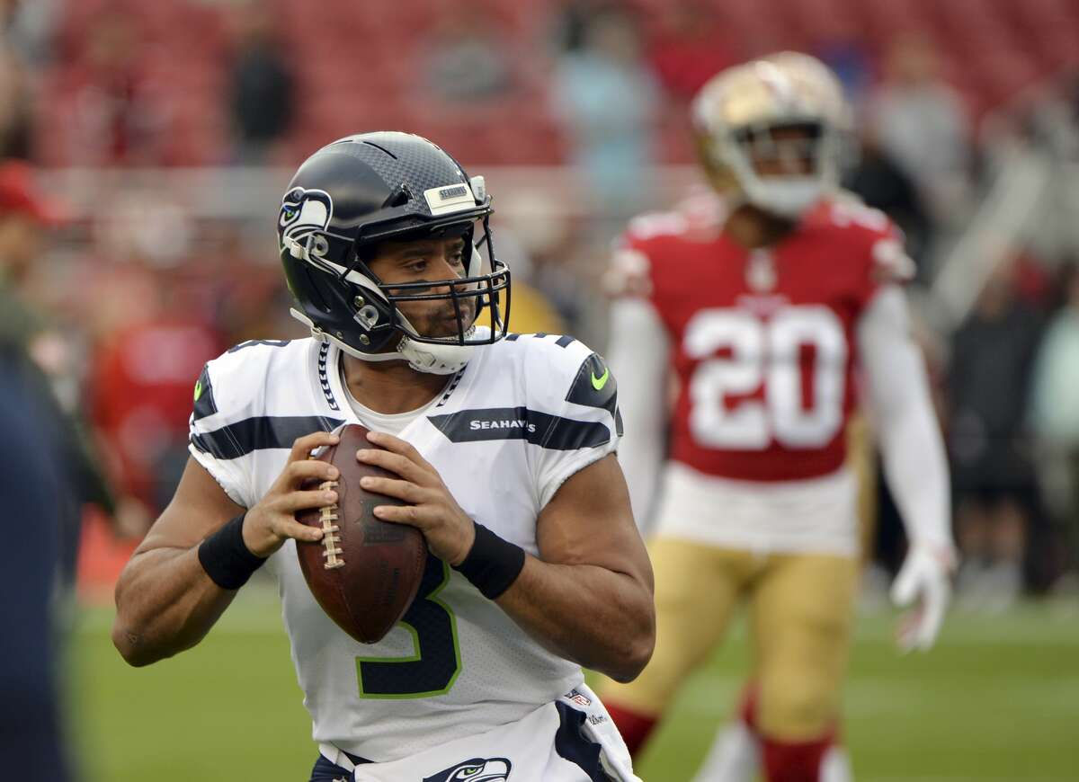 Seattle Seahawks quarterback Russell Wilson warms up before an NFL football game Sunday, Nov. 26, 2017, in Santa Clara, Calif. (AP Photo/Don Feria)