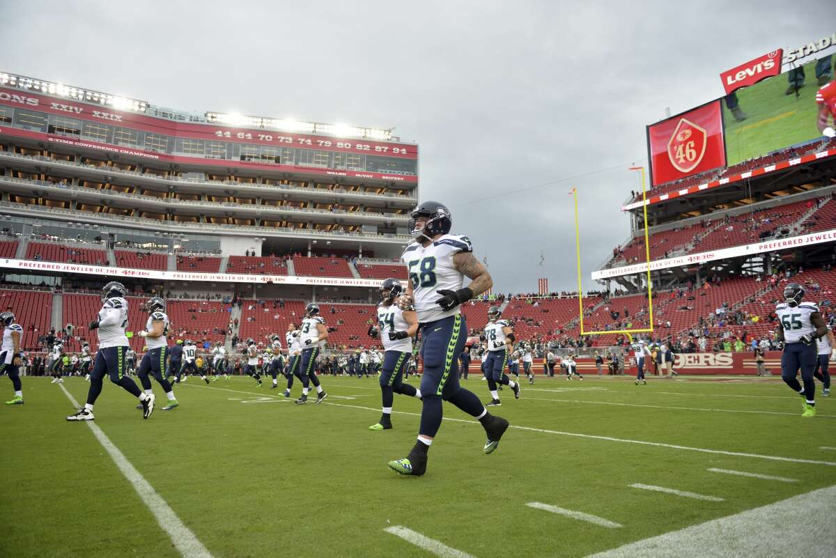 Seattle Seahawks players warm up before an NFL football game against the San Francisco 49ers Sunday, Nov. 26, 2017, in Santa Clara, Calif. (AP Photo/Don Feria)