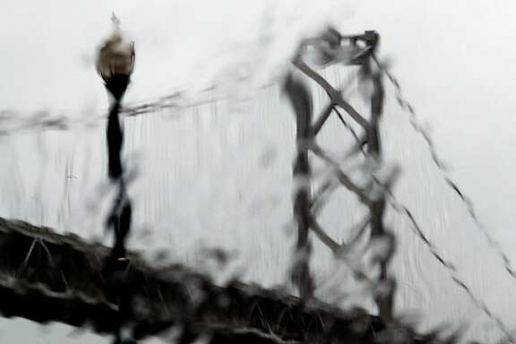 The westernmost tower of the Bay Bridge is seen through runny rain drops on the Embarcadero in San Francisco, Calif., Sunday, November 26, 2017, as a storm dropped several inches of rain throughout the bay
