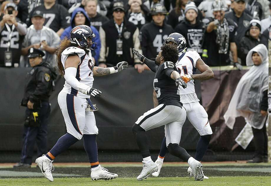 Oakland Raiders wide receiver Michael Crabtree, center, fights with Denver Broncos nose tackle Domata Peko, left, and cornerback Aqib Talib during the first half of an NFL football game in Oakland, Calif., Sunday, Nov. 26, 2017. Crabtree and Talib were ejected.  Photo: Ben Margot, Associated Press