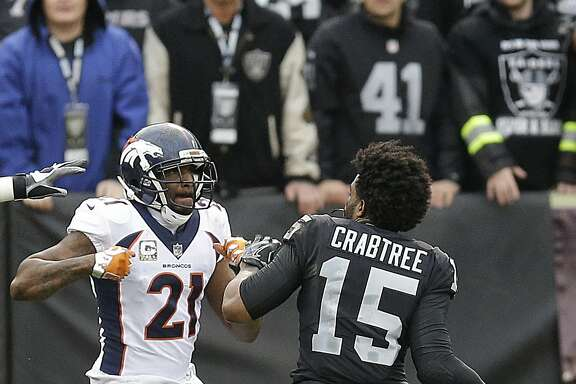 Denver Broncos cornerback Aqib Talib (21) fights Oakland Raiders wide receiver Michael Crabtree (15) during the first half of an NFL football game in Oakland, Calif., Sunday, Nov. 26, 2017. (AP Photo/Ben Margot)