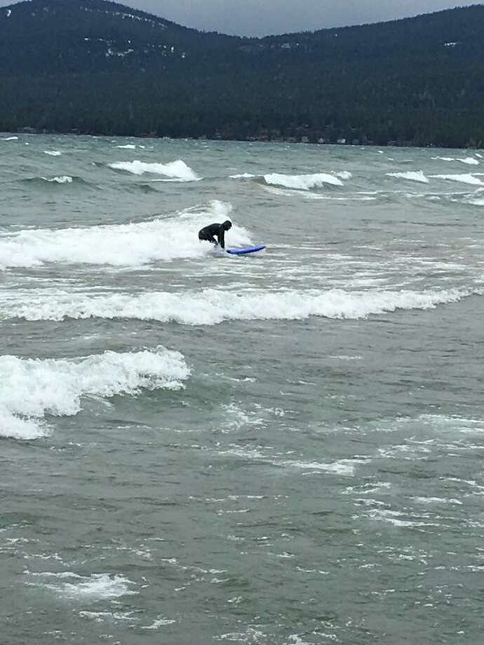 High wind gusts Sunday contributed to spectacular waves at Lake Tahoe. The California Highway Patrol in Truckee met one surfer who ventured out on the lake to catch some of those waves. Photo: Courtesy California Highway Patrol Truckee