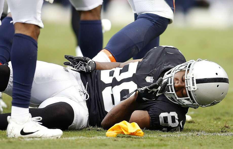 Amari Cooper feels the effects of a collision in Sunday's win over Denver. He received a concussion and an ankle injury. Photo: D. Ross Cameron, Associated Press