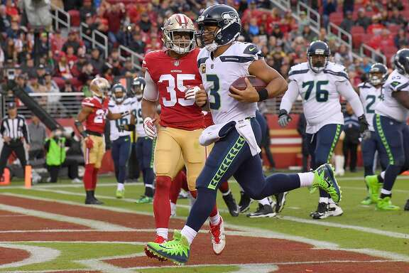 SANTA CLARA, CA - NOVEMBER 26:  Russell Wilson #3 of the Seattle Seahawks scores on a 2-yard touchdown run against the San Francisco 49ers during their NFL football game at Levi's Stadium on November 26, 2017 in Santa Clara, California.  (Photo by Thearon W. Henderson/Getty Images)