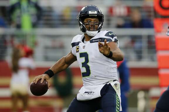Seattle Seahawks quarterback Russell Wilson (3) throws against the San Francisco 49ers during the first half of an NFL football game Sunday, Nov. 26, 2017, in Santa Clara, Calif. (AP Photo/John Hefti)