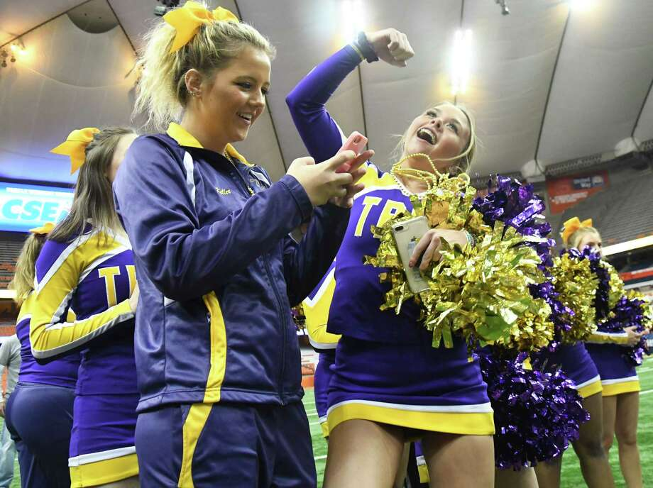Troy High School cheerleaders celebrate their team's win of the Class AA State Football Championship at the Carrier Dome on Sunday in Syracuse. Troy claimed the state title for the second consecutive year by beating Lancaster 41-26. (Jenn March, Special to the Times Union) ORG XMIT: 112717_hsfb Photo: Jenn March, Albany Times Union / © Jenn March 2017-18 © Albany Times Union