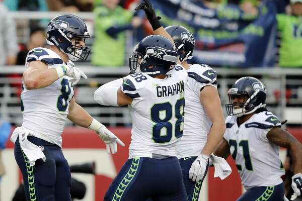 Seattle Seahawks tight end Nick Vannett, left, celebrates his touchdown against the San Francisco 49ers during the second half of an NFL football game Sunday, Nov. 26, 2017, in Santa Clara, Calif. (AP Photo/John Hefti)