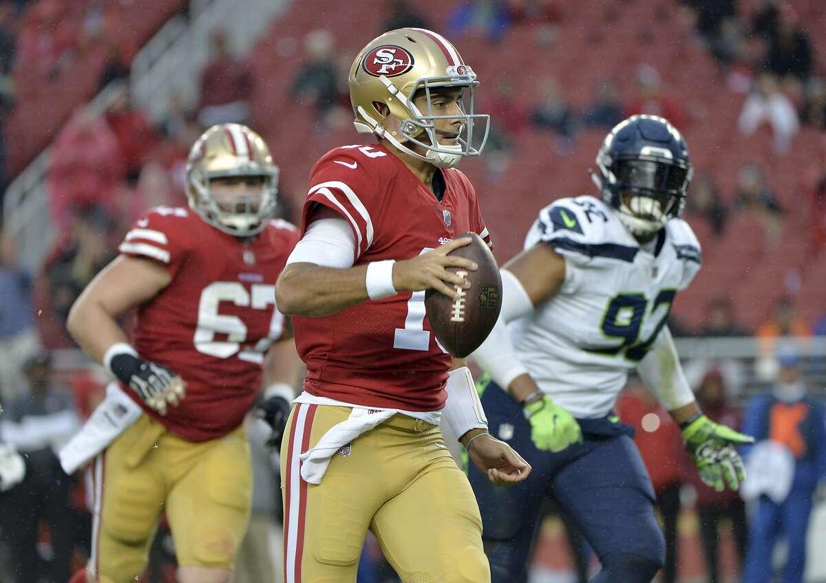 San Francisco 49ers quarterback Jimmy Garoppolo (10) runs against the Seattle Seahawks during the second half of an NFL football game Sunday, Nov. 26, 2017, in Santa Clara, Calif. (AP Photo/Don Feria)