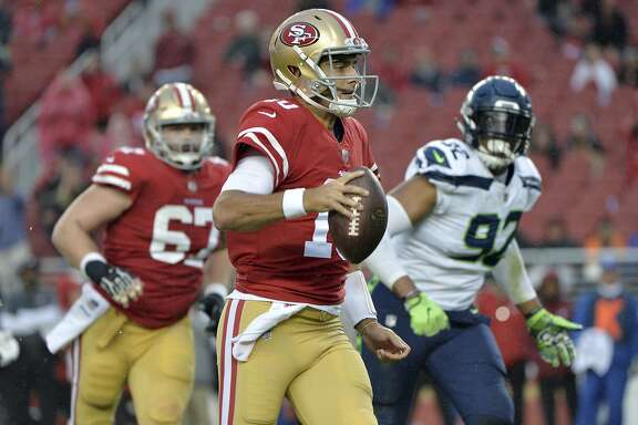 San Francisco 49ers quarterback Jimmy Garoppolo (10) runs against the Seattle Seahawks during the second half of an NFL football game Sunday, Nov. 26, 2017, in Santa Clara, Calif. (AP Photo/Don Feria)