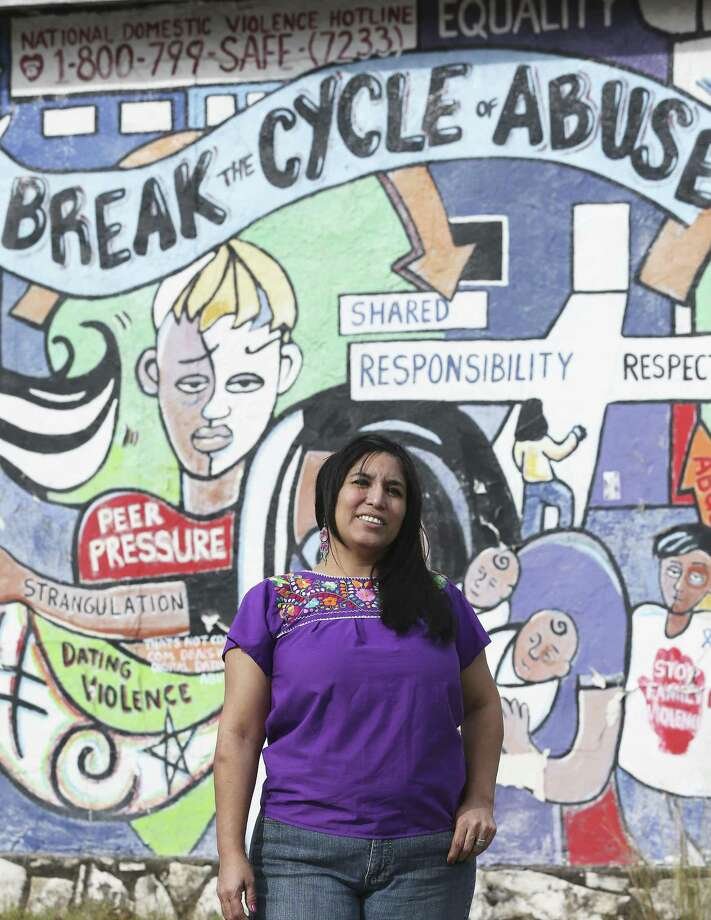 Alexandra Gonzalez stands in front of a mural on Nov. 21, 2017, that advocates for breaking the cycle of domestic abuse. She was attacked by her then-boyfriend nearly five years ago. Photo: Tom Reel /San Antonio Express-News / 2017 SAN ANTONIO EXPRESS-NEWS