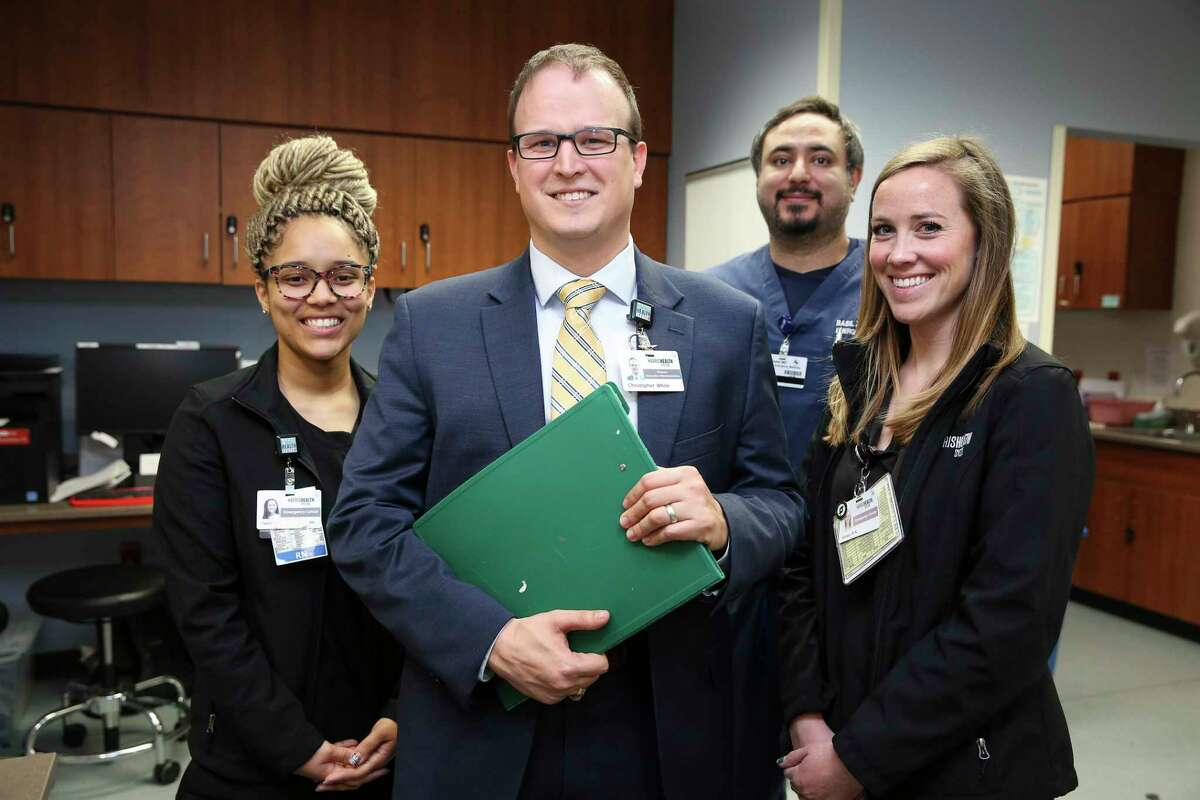 Chris White, 34, center, after he was laid off, changed his career from one in the oil and gas sector to one in the health field with help from Next-Op and Combined Arms,  two nonprofits that provide services to veterans.