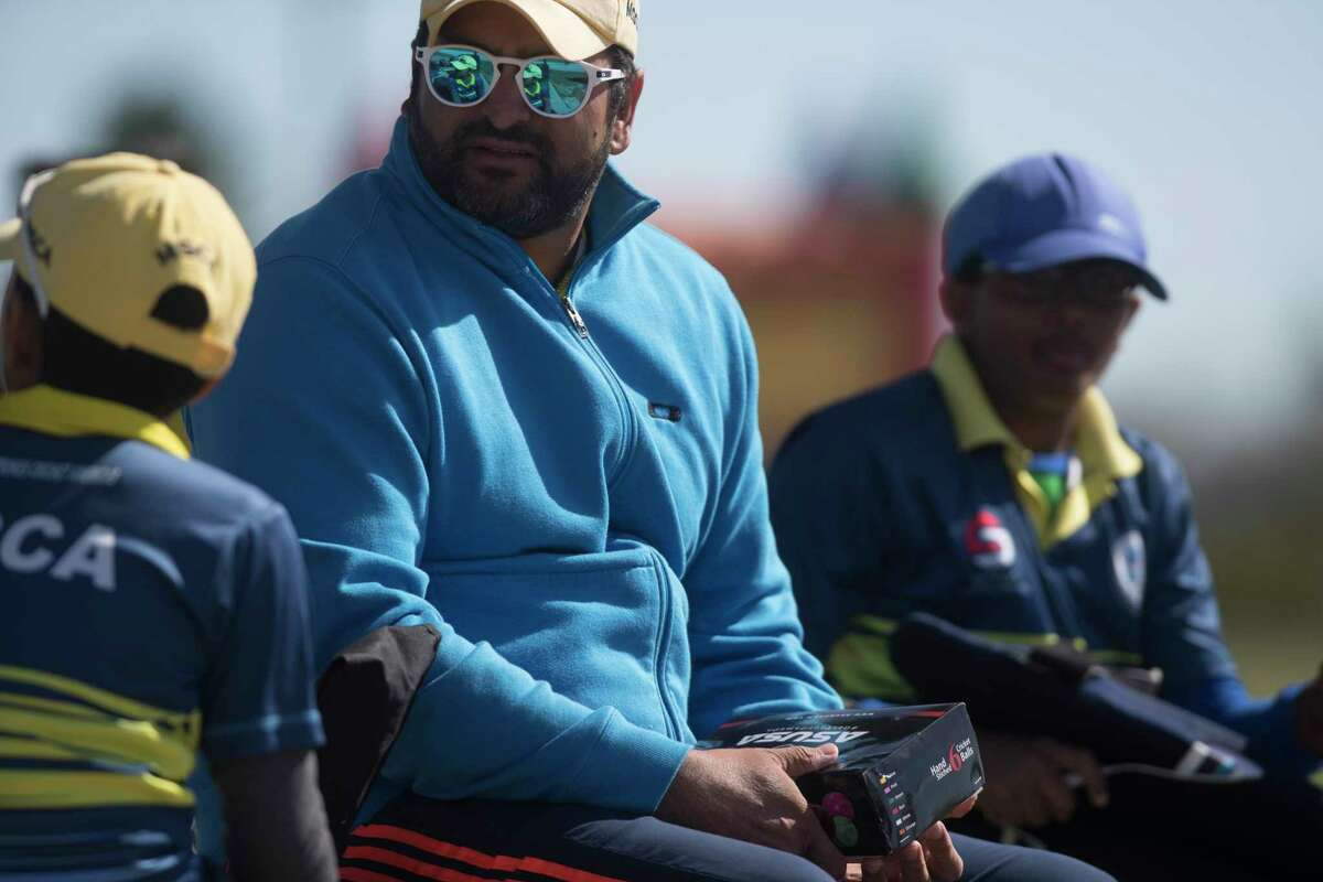 Master Strokes coach and a member of the United States national cricket team Sushil Nadkarni, center, sits with his players during a cricket match, Sunday, Nov. 19, 2017, in Katy. ( Marie D. De Jesus / Houston Chronicle )