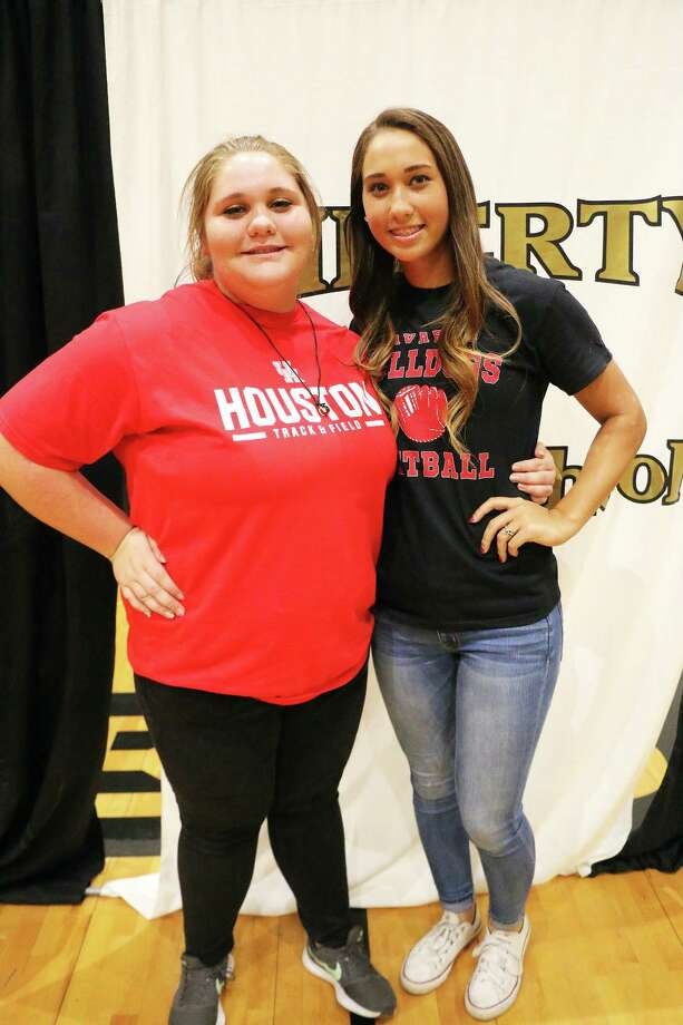 Liberty High School seniors Hannah Hill and Harley Davis are all smiles after they inked their National Letters of Intent to continue their love of sports at the next level. Hill signed with the University of Houston on a track and field scholarship while Davis will go north to play softball for Navarro College. Photo: David Taylor