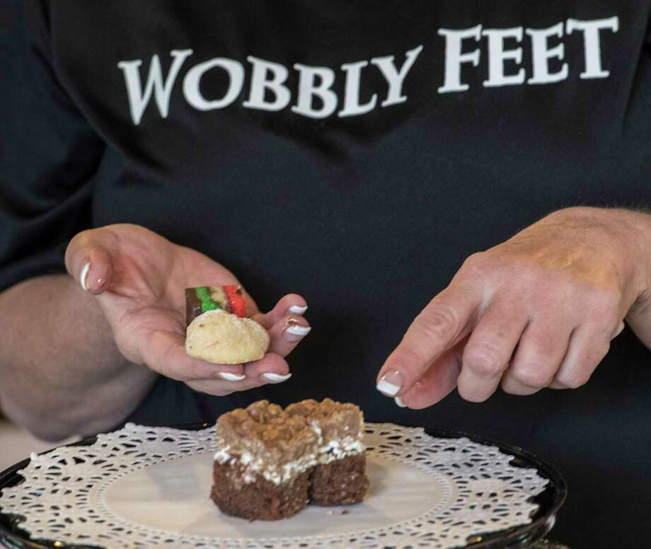 Kathy Dzembo shows of some of the delicious looking cookies she is making as a donation for the Wobbly Feet Foundation in name of her grand nephew Connor Dzembo at her home Wednesday Nov. 15, 2017 in Troy, N.Y.    (Skip Dickstein/ Times Union) Photo: SKIP DICKSTEIN / 20042103A