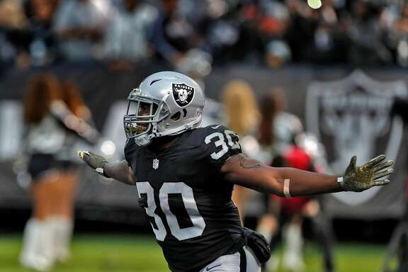 Jalen Richard (30) celebrates his touchdown on a 6-yard pass from Derek Carr (4) in the third quarter as the Oakland Raiders played the Denver Broncos at the Oakland Coliseum in Oakland, Calif., Sunday, November 26, 2017. The Raiders defeated the Broncos 21-14.