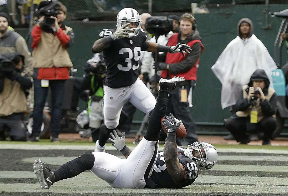 Oakland Raiders linebacker NaVorro Bowman (53) intercepts a pass in the end zone during the first half of an NFL football game against the Denver Broncos in Oakland, Calif., Sunday, Nov. 26, 2017. (AP Photo/Ben Margot) Photo: Ben Margot, Associated Press