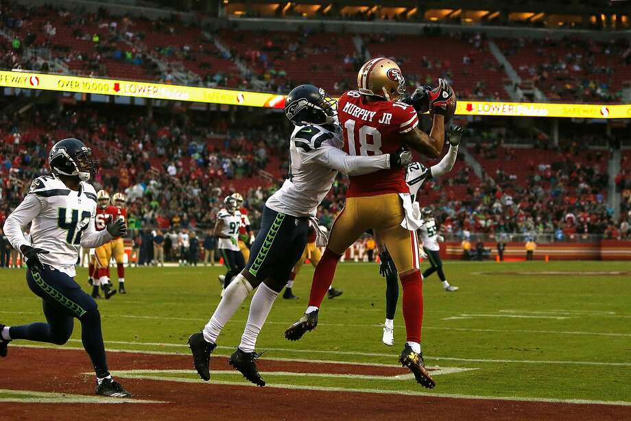 SANTA CLARA, CA - NOVEMBER 26: Louis Murphy #18 of the San Francisco 49ers catches a touchdown pass thrown by Jimmy Garoppolo #10 of the San Francisco 49ers against the Seattle Seahawks at Levi's Stadium on November 26, 2017 in Santa Clara, California. (Photo by Lachlan Cunningham/Getty Images) Photo: Lachlan Cunningham, Getty Images