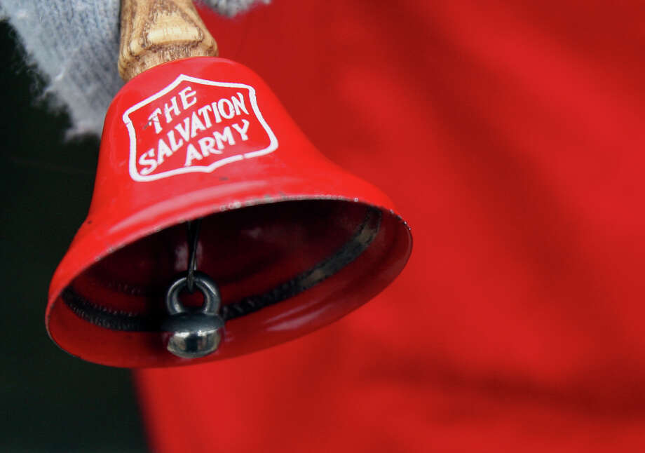 Christmas means the return of bell-ringers at the entrances of many stores. The bells are part of Salvation Army's Red Kettle campaign. Photo: HELEN L. MONTOYA / hmontoya@conexionsa.com