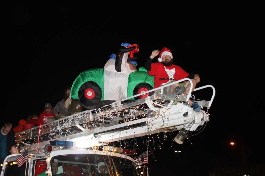 Attorney Donny Haltom sits atop a fire truck owned by fellow attorney Jennifer Bergman and Zack Harkness for the Hometown Christmas lighted parade on Dec. 6, 2016. / Vanesa Brashier