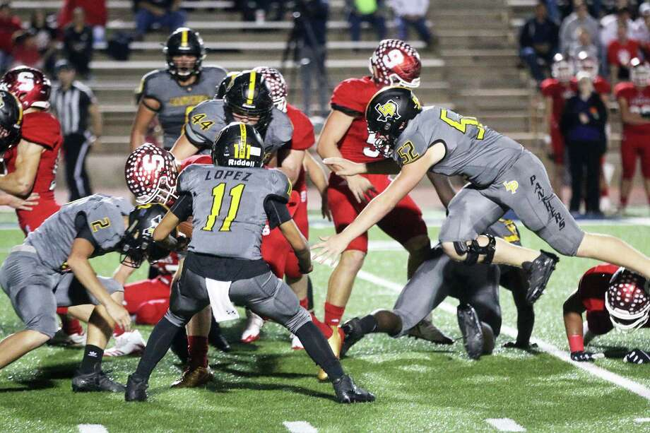 Panther junior Keaton Parker is airborne as he zooms in on a tackle of one of the Salador Eagle runners at the playoff game last Saturday in Bryan. Photo: David Taylor