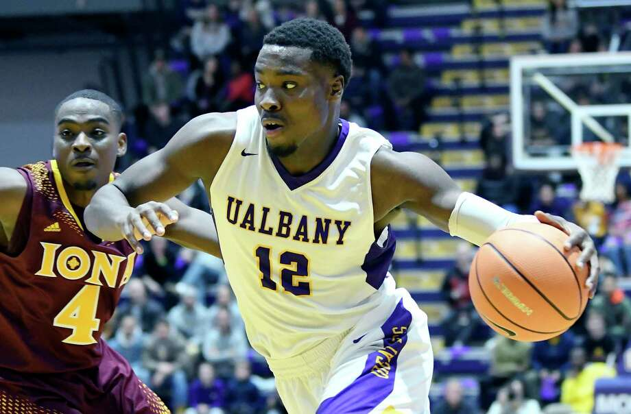 Albany Great Danes forward Devonte Campbell (12) drives to the basket past Iona Gaels guard Schadrac Casimir (4) during the first half of an NCAA men's college basketball game on Friday, Nov. 10, 2017, in Albany, N.Y. (Hans Pennink / Special to the Times Union) ORG XMIT: HP108 Photo: Hans Pennink / 20042056A
