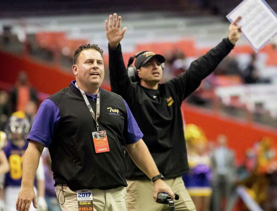 Troy coaches call out to their players following the call of a personal foul against Troy during the Class AA State Football Championship at the Carrier Dome on Sunday in Syracuse. Troy claimed the state title for the second consecutive year by beating Lancaster 41-26. (Jenn March, Special to the Times Union) ORG XMIT: 112717_hsfb Photo: Jenn March / © Jenn March 2017-18 © Albany Times Union