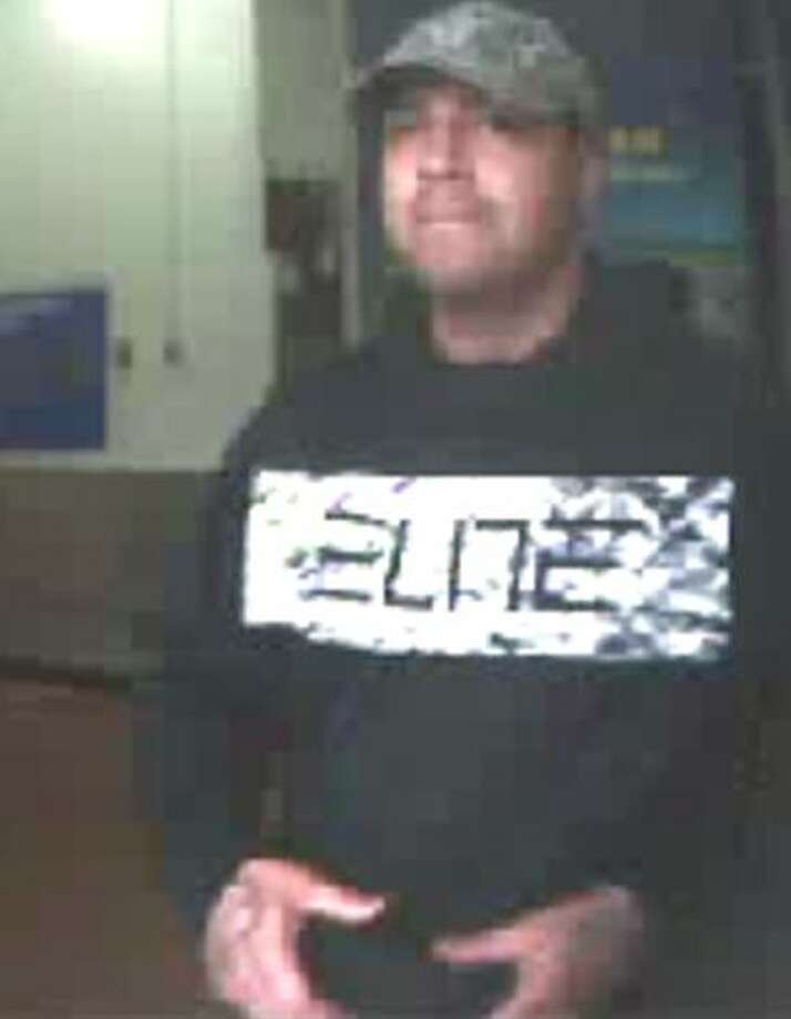 The suspect, who has not been identified, walked into the Walmart in the 8900 block of West Military Drive on November 15 and asked to see a new cell phone. Photo: Crime Stoppers
