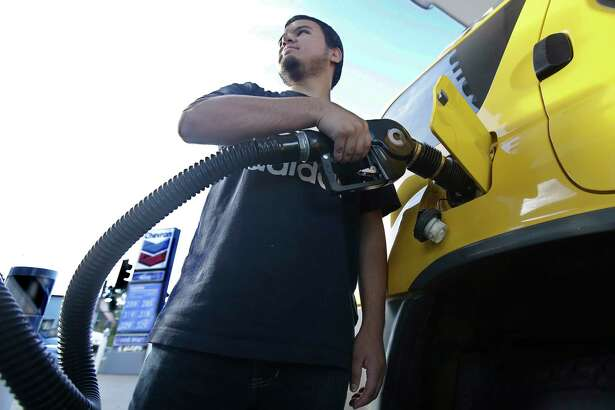 In this photo taken Monday, Oct. 30, 2017, Cristian Rodriguez fuels his vehicle, in Sacramento, Calif. Gasoline taxes will rise by 12 cents per gallon Wednesday, Nov., 1, to raise money for fixing roads and highways. It is the first of several tax and fee hikes that will take effect after they were approved by the Legislature earlier this year. (AP Photo/Rich Pedroncelli)