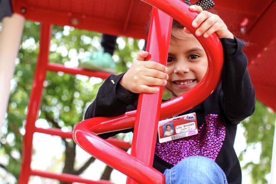 A girl plays at one of the many SPARK parks in Houston. SPARK is a nonprofit that works with schools to turn playgrounds into neighborhoods parks in the evening. Photo: PISD