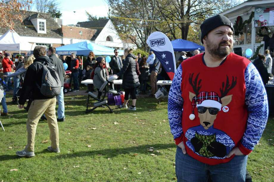 "Albert Dzurka, a fifth-generation Fairfield resident, enjoys an annual tradition at ""Santa's Arrival, "" the annual Chamber of Commerce event at Sherman Green, Saturday, Nov. 25, 2017, in Fairfield, Conn. Photo: Jarret Liotta / For Hearst Connecticut Media / Fairfield Citizen News Freelance"