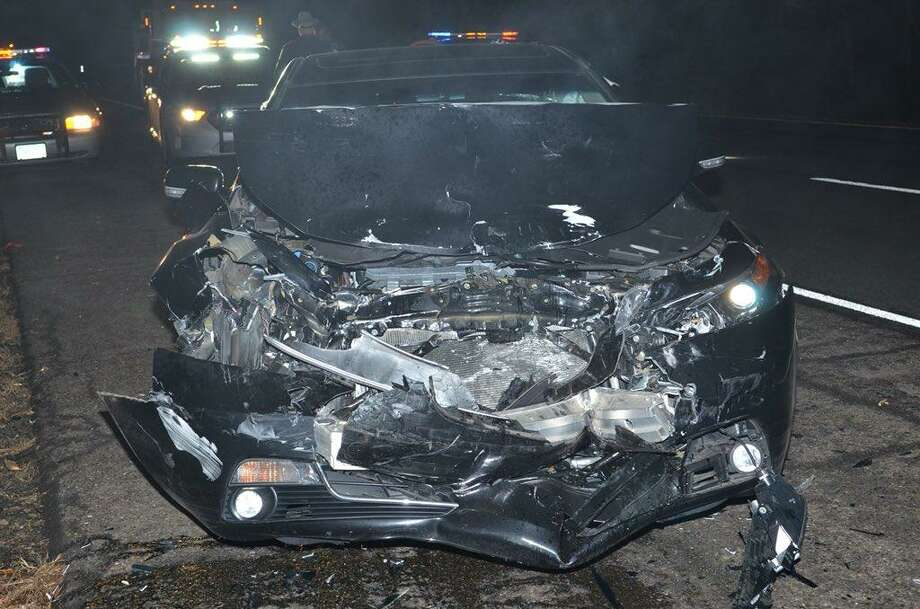 While investigating a fatal I-91 crash on Nov. 25, 2017 in Cromwell, state police say said a driver failed to obey a trooper's signal and DOT lane/ramp closures and struck the a cruiser. The trooper was not hurt. The driver of that vehicle, Martin Jackson, 29, of Hartford, was charged with operating under the influence of drugs and alcohol, operation of an unregistered vehicle and failure to drive in the proper lane. Photo: State Police Photo