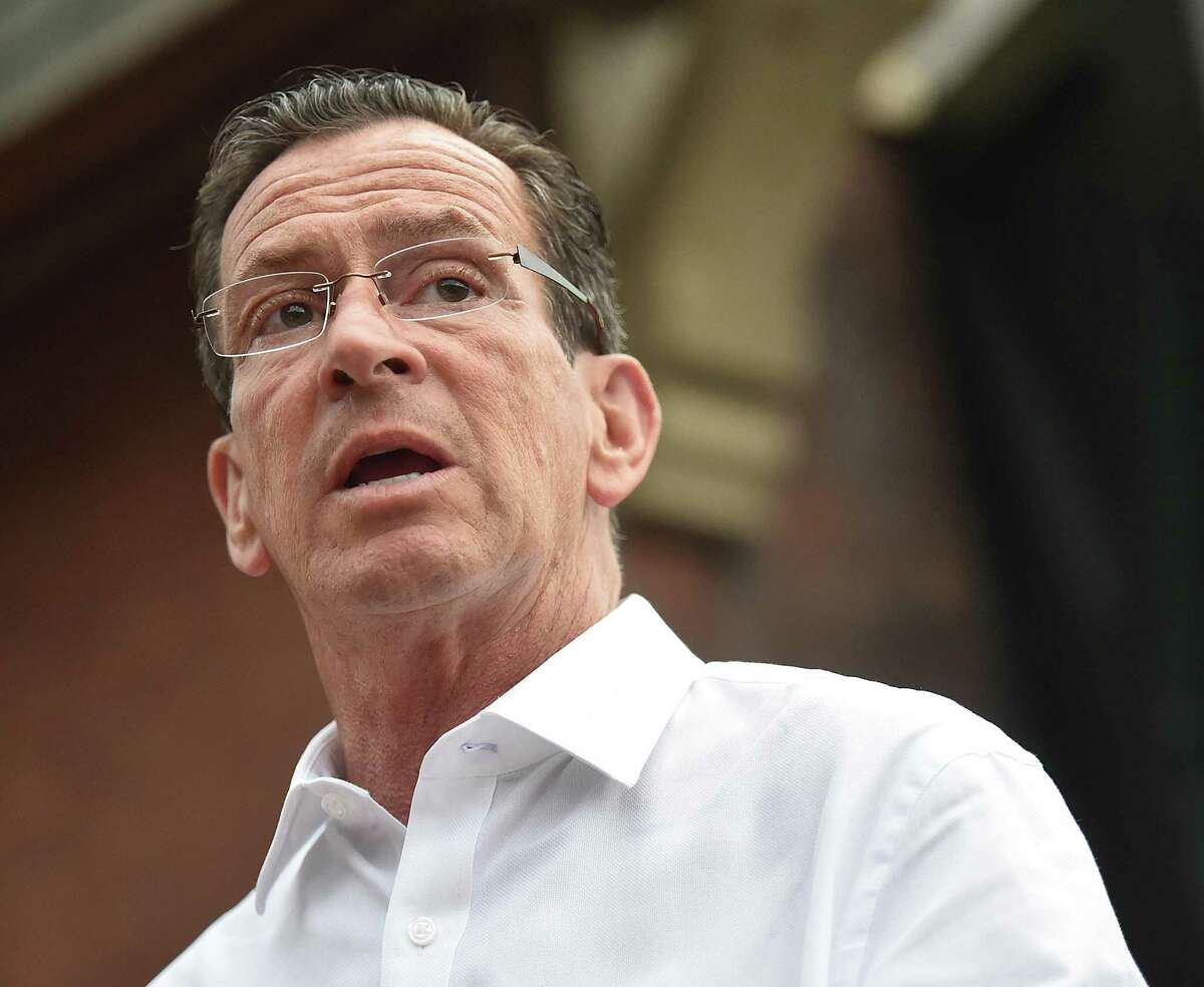 FILE PHOTO - Gov. Dannel P. Malloy speaks at a press conference in July (Catherine Avalone Hearst Connecticut Media)