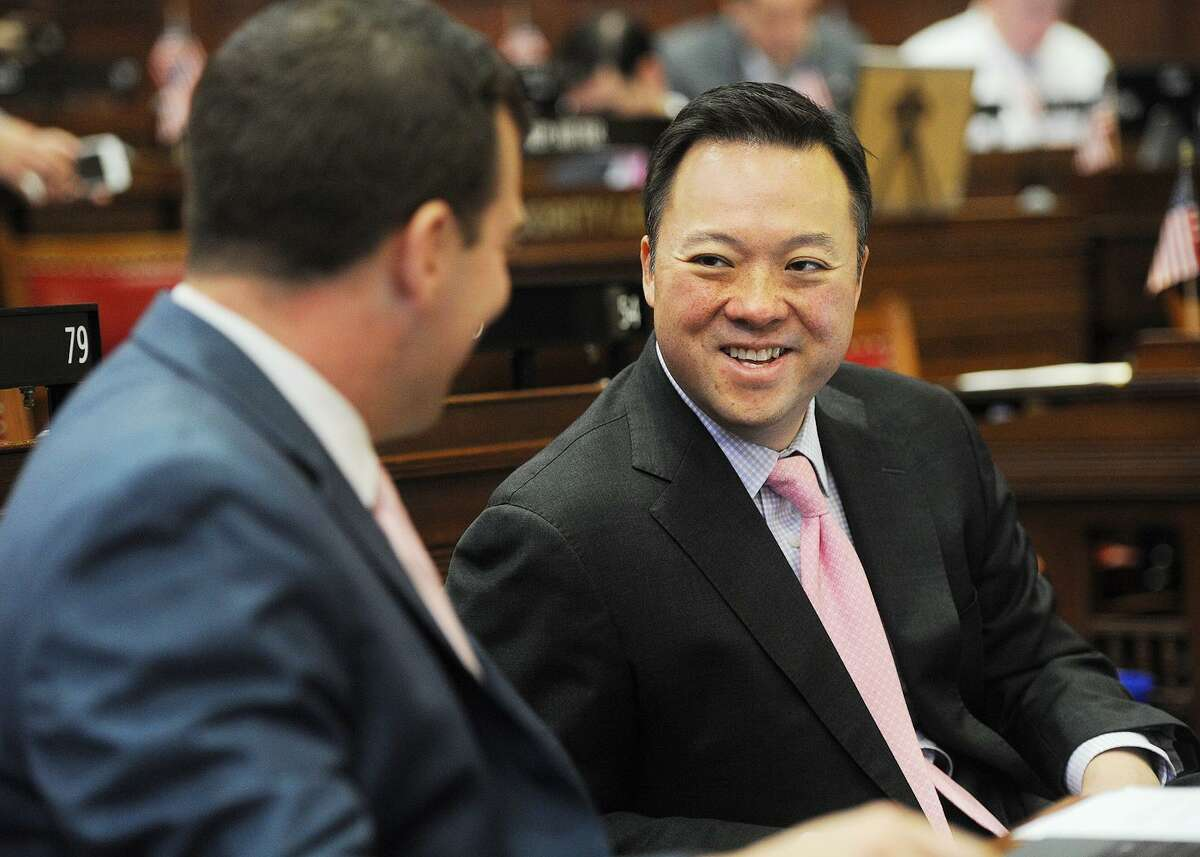 Rep. Steve Stafstrom, D-Bridgeport, left, chats with Rep. William Tong, D- Stamford, at the Capitol in June.