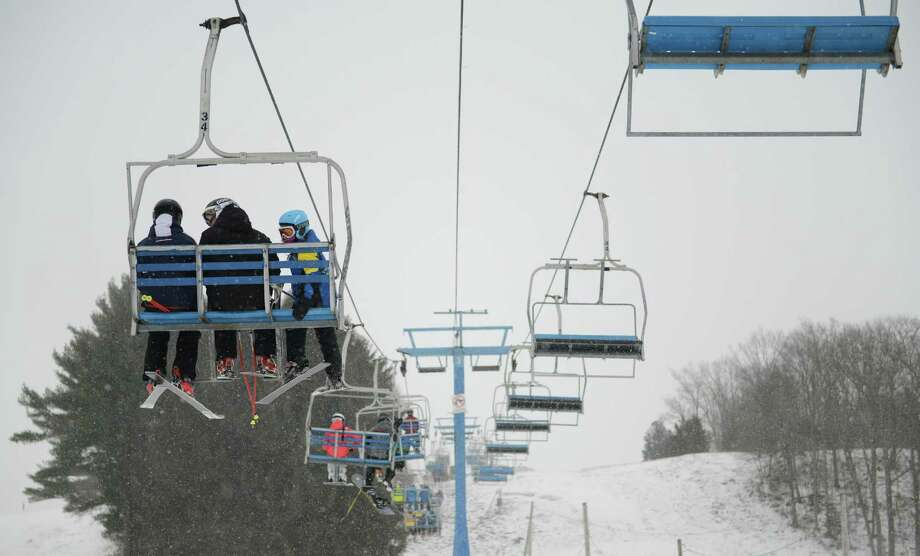 Skiiers and snowboarders ride the lift to the top of the mountain at Thunder Ridge Ski Area in Patterson, N.Y. in this file photo. Photo: Tyler Sizemore / Tyler Sizemore / The News-Times