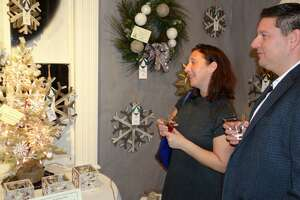 Visitors admire the decor at a previous Fairfield Christmas Tree Festival. This year's event runs Nov. 30 through Dec. 3 at the historic Burr Homestead.