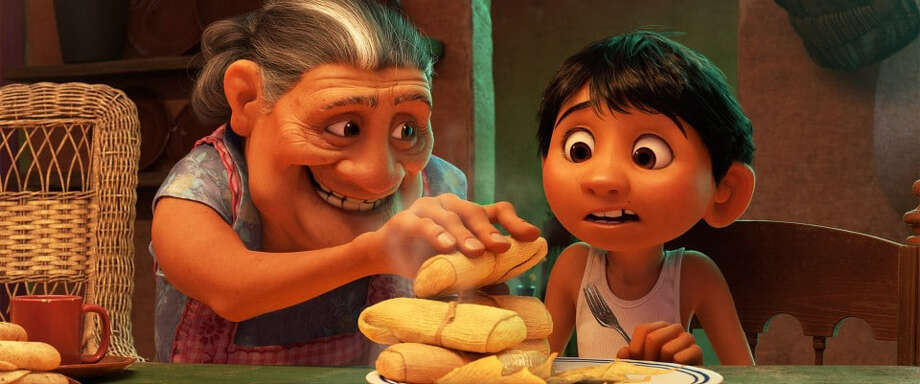 "In Disney/Pixar's ""Coco,"" Abuelita (Renée Victor) serves Miguel (Anthony Gonzalez) what's piping hot. Photo: Walt Disney Pictures-Pixar Animation Studios / Handout"
