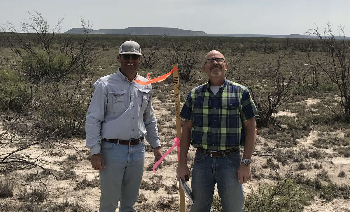 Ken Ross with MMEX Resources and Mike Bobo, managing consultant with Trinity Consultants, stand at the northwest corner state for the Pecos County Refinery project. Trinity is working with MMEX on the air quality environmental permits needed for the refinery.