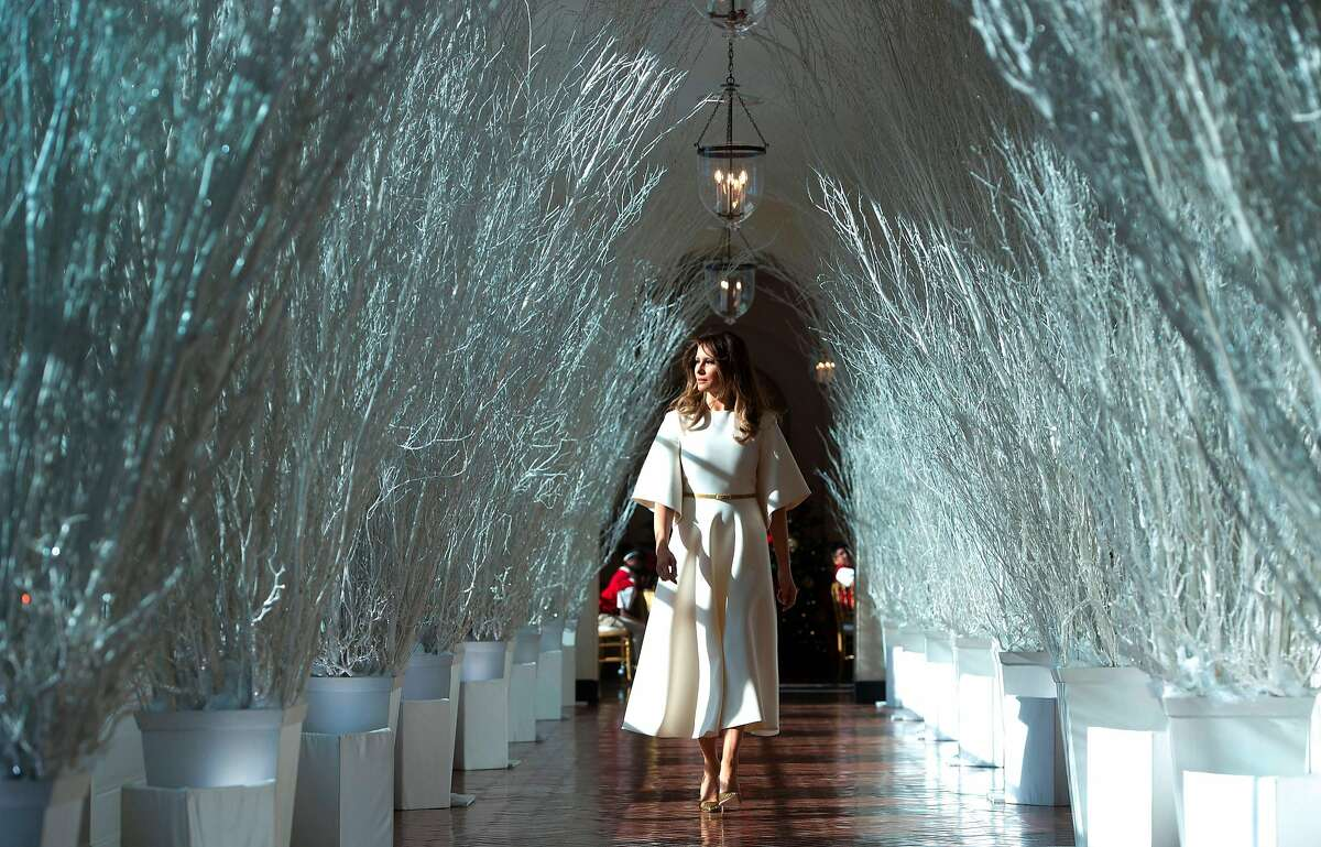US First Lady Melania Trump walks through Christmas decorations in the East Wing as she tours holiday decorations at the White House in Washington, DC, on November 27, 2017. / AFP PHOTO / SAUL LOEBSAUL LOEB/AFP/Getty Images