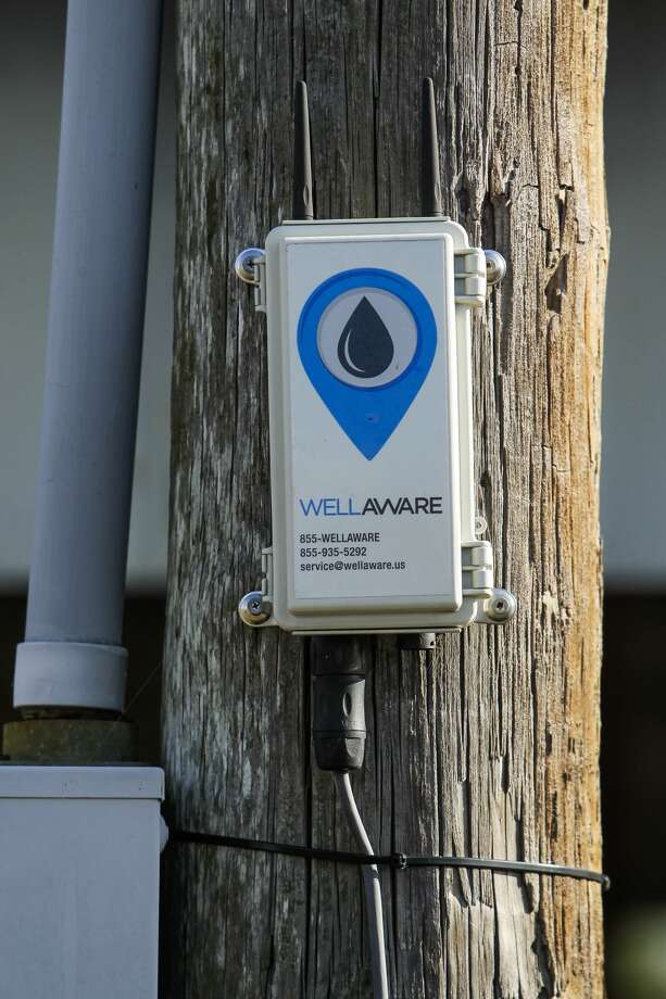 A WellAware sensor sits on a telephone pole near a Welder Exploration & Production, Inc. compressor Monday, Nov. 9, 2015, in Beeville. The sensor monitors the oil systems and allows operators to view the operational data remotely. ( Michael Ciaglo / Houston Chronicle ) Photo: Michael Ciaglo/Houston Chronicle
