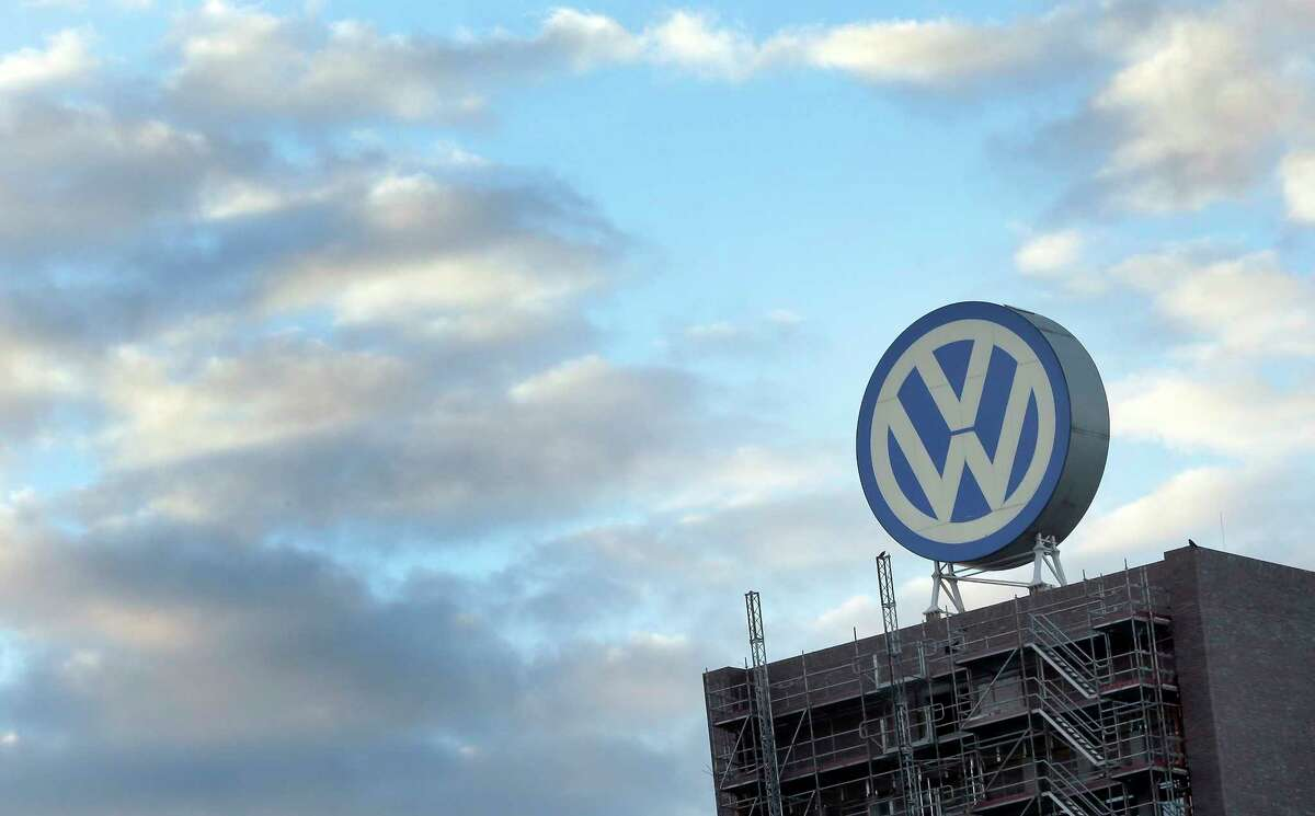 FILE - In this Sept. 26, 2015 file photo a giant logo of the German car manufacturer Volkswagen is pictured on top of a company's factory building in Wolfsburg, Germany. (AP Photo/Michael Sohn, file)